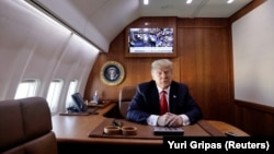 U.S.A. -- President Donald Trump aboard Air Force One October 6, 2018.