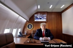 President Donald Trump in an office inside Air Force One in 2018.
