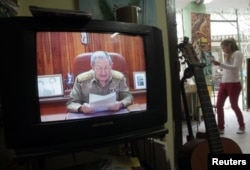 اوباما و کاسترو در حال اعلام همزمان خبر عادی سازی روابط