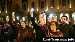 Demonstrators gather at the Georgian parliament building in Tbilisi on the evening of November 14.