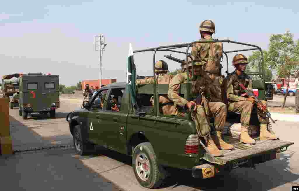 Pakistani Army rescue and relief teams leave Karachi for the earthquake-hit areas in Balochistan Province.