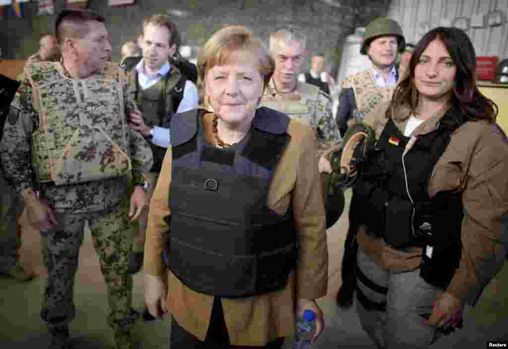 Chancellor Angela Merkel sports a flak jacket after arriving in the Afghan city of Mazar-e Sharif in May 2013 to meet with German soldiers.