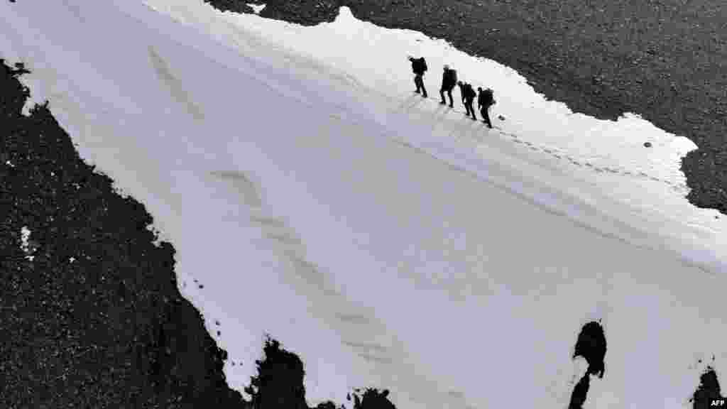 Climbers trek to the top of the 4446-meter-high Vladimir Putin Peak in Kyrgyzstan's Tian Shan Mountains. (AFP/Vyacheslav Oseledko)