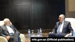 Elmar Məmmədyarov (sağ) Javad Zarif