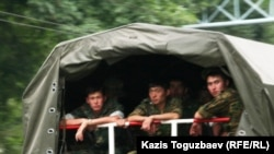 Kazakhstan - Prisoners riot. Soldiers in military truck. Almaty, 30Jul2010.