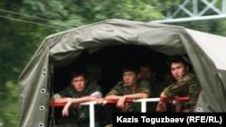 Kazakhstan - Prisoners riot. Soldiers in military truck. Almaty, 30Jul2010.