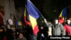Demonstrators at a rally calling for Moldova's unification with Romania in Bucharest on October 22