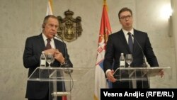 Russian Foreign Minister Sergei Lavrov (left) and Serbian President Aleksandar Vucic meet reporters in Belgrade on February 21.