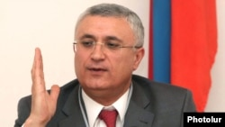 Armenia - Garegin Azarian, chairman of the Central Election Commission.