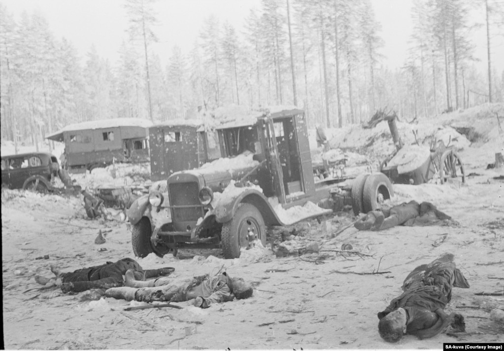 Dead Soviet soldiers and vehicles riddled with bullet holes in February 1940.