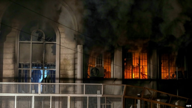 Smoke pours out of the windows of the burning Saudi Arabian Embassy during anti-Riyadh protests in Tehran on January 2.