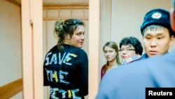 Greenpeace activist Anne Mie Roer Jensen (left) of Denmark looks on during a hearing at the Primorskiy Court in St. Petersburg on November 20.