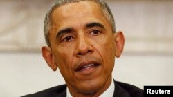 АҚШ президенті Барак Обама Ақ үйде Париждегі Charlie Hebdo журналына жасалған шабуылды айыптап сөйлеп тұр. Вашингтон, 7 қаңтар 2014 жыл.