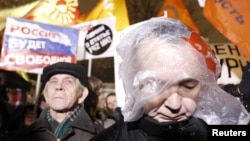Участники акции протеста в Москве 5 декабря
