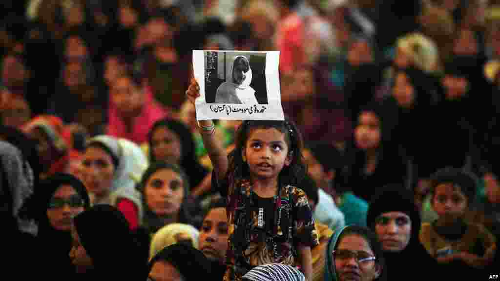 A Pakistani girl holds a photograph of Malala Yousafzai, a young activist who was shot by the Taliban, aloft during a rally in Karachi. (AFP/Rizwan Tabassum)