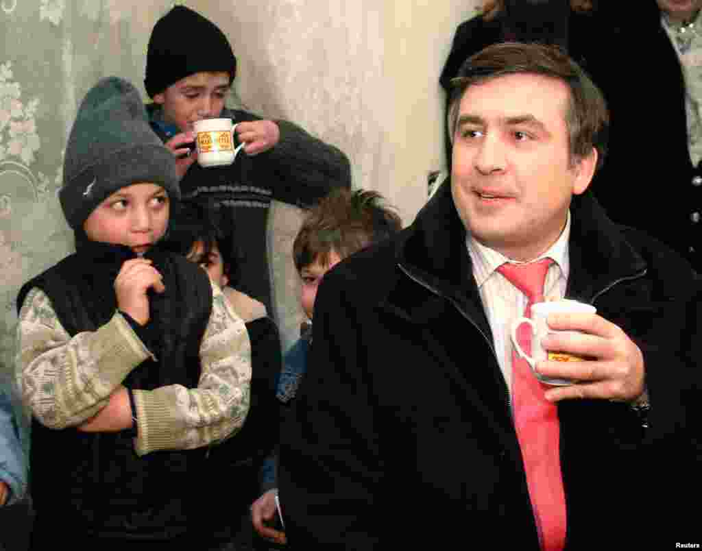 President Mikheil Saakashvili visits an orphanage in Tbilisi on January 23, 2006.