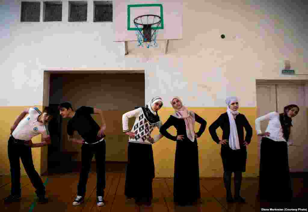 Gym class at School No. 1 in Serzhen-Yurt. The schoolgirls, all dressed in skirts and head scarves, say gym clothes violate Muslim dress codes.