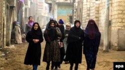 Родственники казненных коптских христиан, похищенных и убитых экстремистами ИГ. Эль-Минья, 16 февраля 2015 года.
