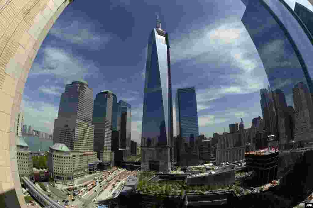 The final section of the spire sits on top of One World Trade Center in New York after it was fully installed on the building's roof. With the spire now in place, One WTC stands 541 meters high, making it the tallest building in the Western Hemisphere. (AFP/Timothy A. Clary)