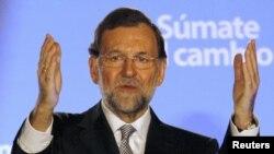 """Лидер правоцентристов Мариано Рахой, недавно ставший новым премьер-министром, предложил """"непопулярные"""" в народе меры по спасению испанской экономики."""