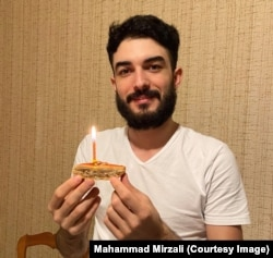 Mirzali celebrates his 27th birthday with a slice of baklava earlier this year.