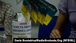 Ukraine -- Blue and yellow flags instead the usual bouquets on the 1 September, Cherkasy, 01Sep2014