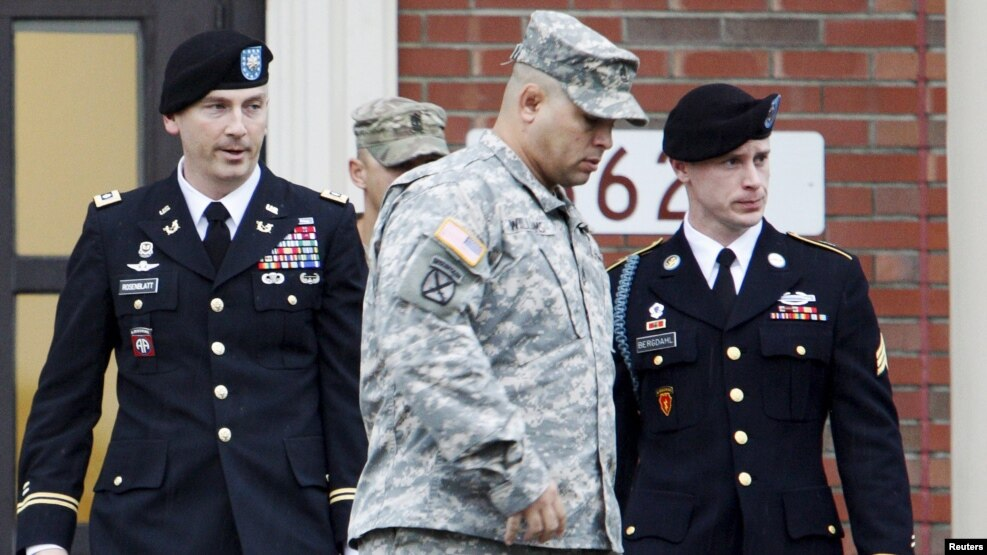 U.S. Army Sergeant Bowe Bergdahl (right) leaves a courthouse after an arraignment hearing for his court-martial in Fort Bragg, North Carolina, in December 2015.
