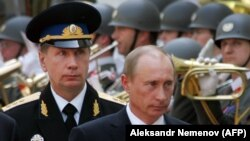 Russian President Vladimir Putin wants bodyguard Viktor Zolotov (left) to head the new National Guard.