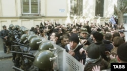 Opposition supporters clash with police during their protest downtown Tbilisi on November 22, 2003.