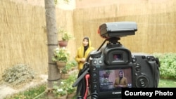 Zuhra Nawrozi being photographed in Kabul