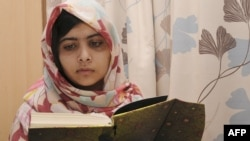 Malala Yousafzai reading at the Queen Elizabeth Hospital in Birmingham.