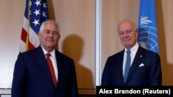 U.S. Secretary of State Rex Tillerson (L) pose for the picture with U.N. Special Envoy for Syria Staffan de Mistura before their meeting at the U.S. Mission to the U.N. in Geneva, October 26, 2017
