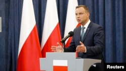 Polish President Andrzej Duda speaks to reporters at the Presidential Palace in Warsaw on July 24.