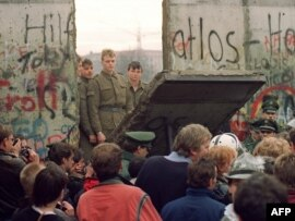The Berlin Wall came down almost one year before reunification.