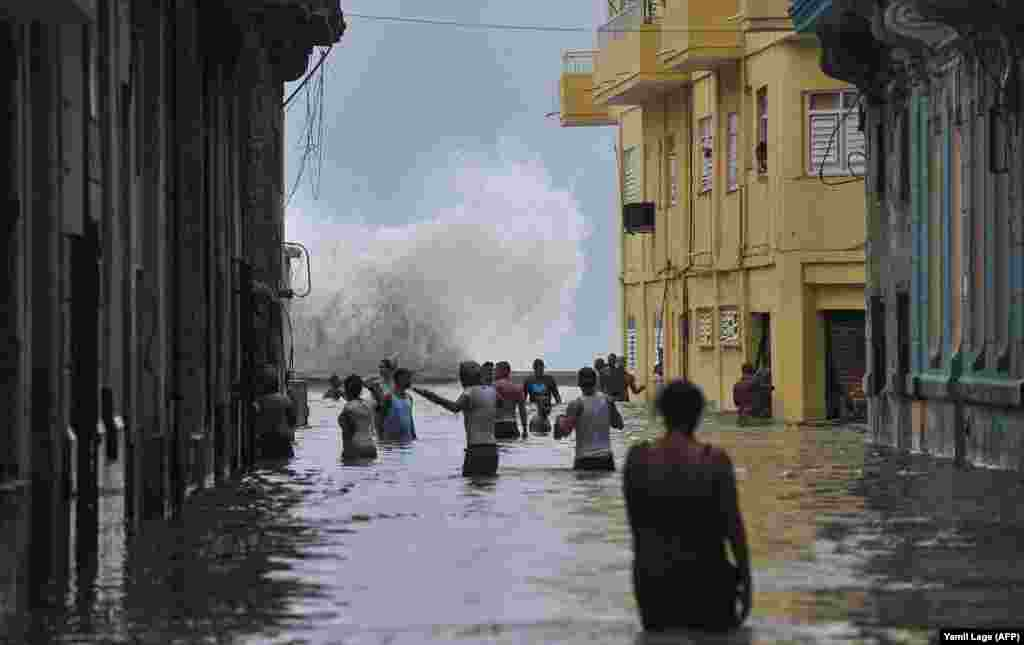 Cubans wade through a flooded street in Havana on September 10 as Hurricane Irma battered the island. (AFP/Yamil Lage)