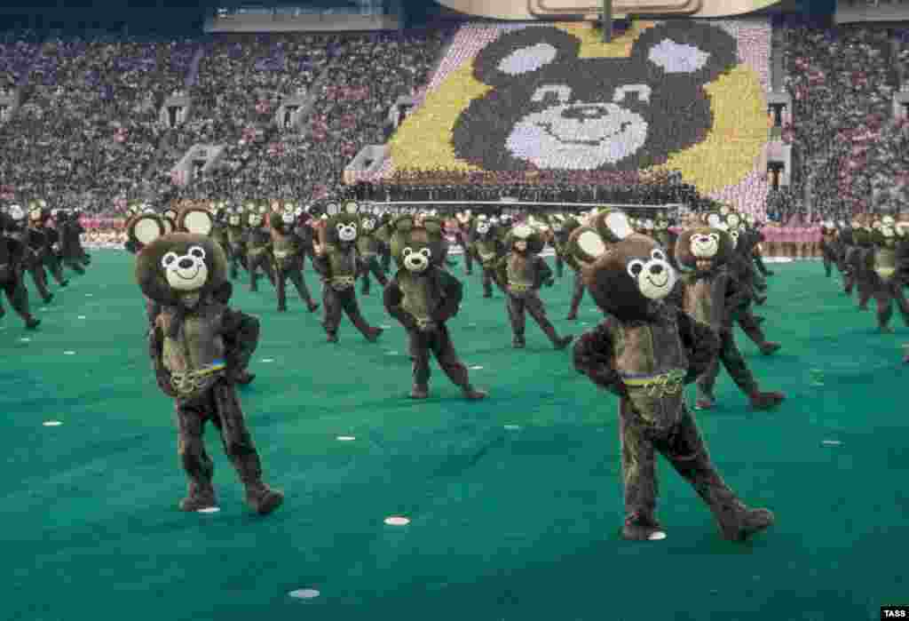 Dozens of performers are dressed as Misha, the Olympic mascot, at Luzhniki Stadium in Moscow during the opening ceremonies.