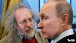 "Then-Prime Minister Vladimir Putin pilloried Ekho Moskvy editor in chief Aleksei Venediktov (left) at a January 2012 meeting of editors of major news outlets, saying the station ""pours diarrhea on me day and night."""