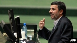 Iranian President Mahmud Ahmadinejad addresses parliament before presenting his proposed budget in Tehran on February 1.