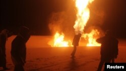 Солтүстік Синай аймағындағы әл-Ариш қаласына жақын газ құбырында болған жарылыс. Египет, 28 қараша 2011 жыл.