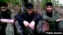 Chechen rebels like Doku Umarov (center in low-quality still from Internet video) have frequently used YouTube to spread their message beyond Russia's borders.