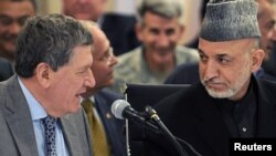 President Hamid Karzai speaks with US Special Representative for Afghanistan and Pakistan Richard Holbrooke in Kabul