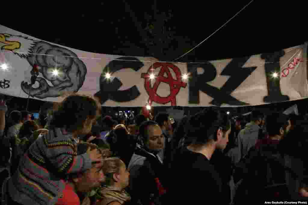 "The banner of Carsi, a Besiktas support group. The group, which replaces the letter ""A"" with an anarchist symbol, espouses left-wing political thought."