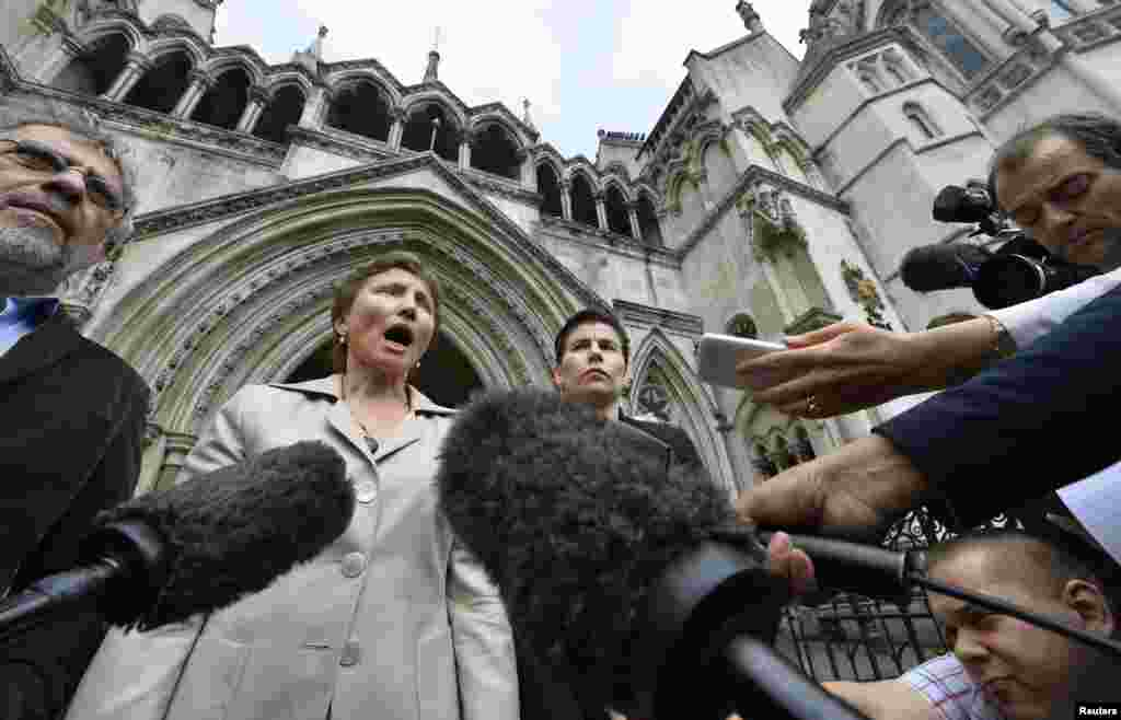 Marina Litvinenko speaks to the media as she leaves the High Court in London on July 12, 2013, amid calls fora public inquiry into her husband's death.
