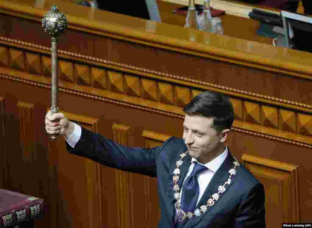New President Volodymyr Zelenskiy holds the Ukrainian symbols of power during his inauguration ceremony in Kyiv on May 20. (AP/Efrem Lukatsky)