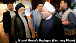 The two main contenders in the May 19 Iranian presidential elections