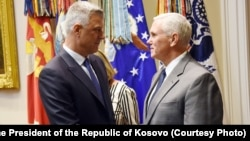 Kosovo President Hashim Thaci (left) is received at the White House by U.S. Vice President Mike Pence in Washington, D.C., on September 29.