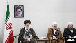 """Taqiyyeh, anyone?"" Iran Supreme Leader Ali Khamenei (left) and Akbar Hashemi Rafsanjani (center) in Tehran on February 25"