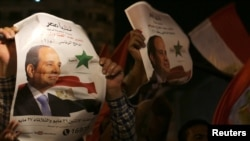 Абдел Фаттах әл-Сисидің жақтастары Каирдегі Тахрир алаңында. Египет, 27 мамыр 2014 жыл.