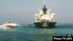 The Panamanian-flagged oil tanker MT Riah is surrounded by Iranian Revolutionary Guard vessels, undated.