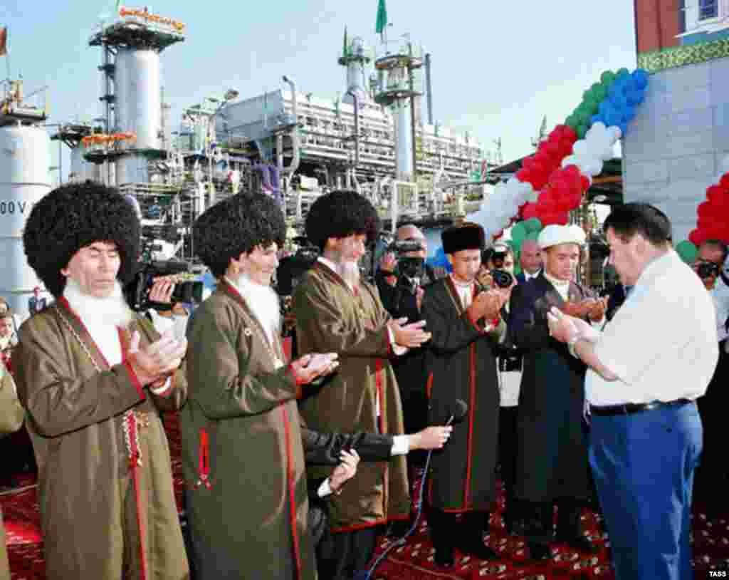 Niyazov (right) prays with local clergy at the opening of a gas-compressor station in September 2005 (TASS) - Although generally a poor, arid country, Turkmenistan has the world's fifth-largest reserves of natural gas and substantial oil resources. It produces about 60 billion cubic meters of gas annually, but two-thirds of it is sold to Russia's Gazprom, because Turkmenistan's export infrastructure is poorly developed.